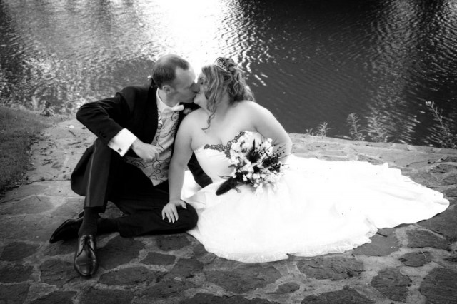 Kissing by the pond at The Bolholt Hotel, Bury